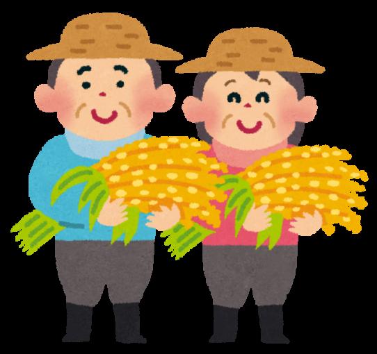 刈り取った稲を持つ農家夫婦