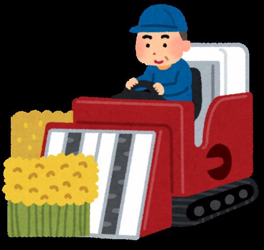 稲刈り機に乗って稲を刈るおじさん
